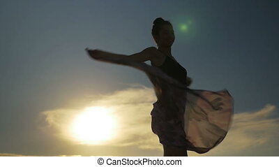 Young beautiful female dancing and holding her transparent...