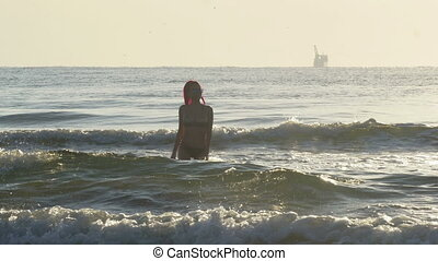 Female coming out of the sea waves