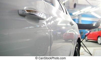 Door handle of the car - automobiles stands in garage, slider