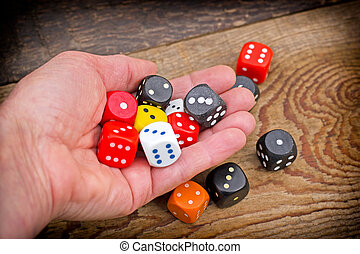 Let's play - gambling addiction - Hand throws dice on...