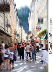Crowd on a narrow city street Motion blur effect