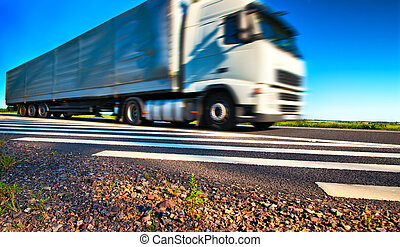 Truck transportation. Wide angle view and blurred motion...