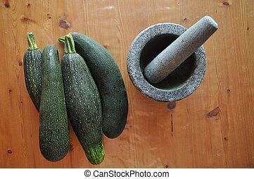 Courgette. Preparing vegetable dishes in a mortar.