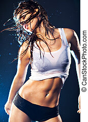 Young sexy dancing woman. With drops of water.