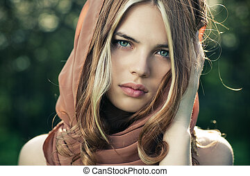 Young woman portrait - Young tranquil woman outdoors...