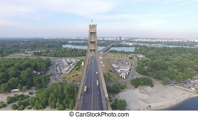 Flying over the Moscow bridge in Kiev. Ukraine. Aerial view....