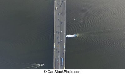 Flying in the copter over the bridge across the river. -...