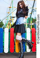 Young schoolgirl in amusement park