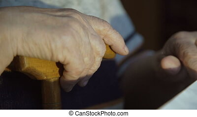 Old hands and stick. The old hands grandmother 4k.