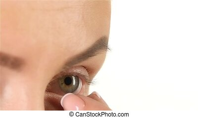 Girl with poor eyesight removes the lens. Close up. White...