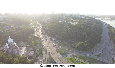 Road junction with heavy traffic in Kyiv, Ukraine. Park of...