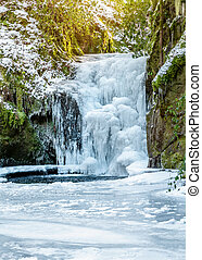 Forest waterfall in Baden-Baden in winter. Europe, Germany