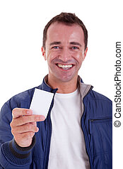 Portrait of a handsome man, with blank business card in hand, isolated on white background. Studio shot.