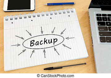 Backup - handwritten text in a notebook on a desk with...