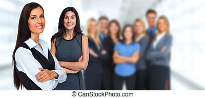 Business team. - Smiling business people group over blue...