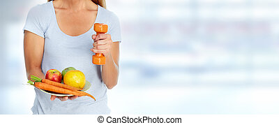 Beautiful lady with dumbbell and food - Healthy woman with...