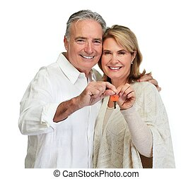 Senior couple with house key. - Mature couple with house...