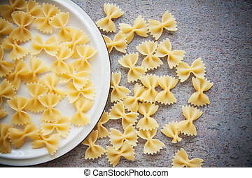 cooking ingredients: farfalle pasta with vegetables - raw...