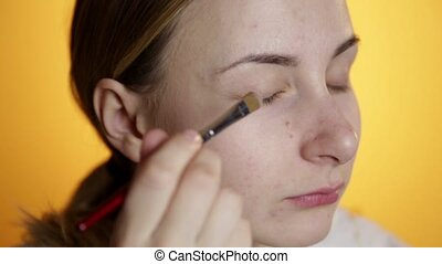 Young Woman Putting On Makeup.