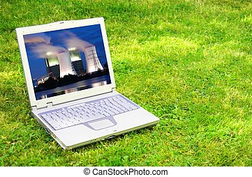 power plant in laptop or notebook screen showing energy...