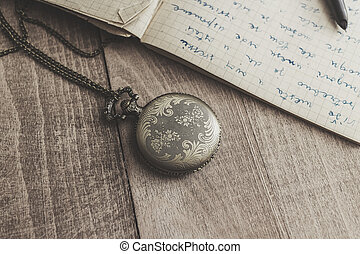 Vintage pocket  watch with pen and paper