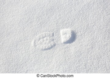 Single foot step on snow ground.