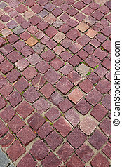 red granite pavers on the sidewalk