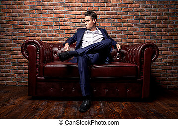 imposing young man - Imposing well dressed man in a...