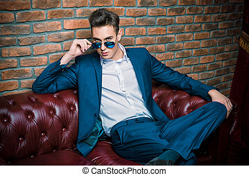 dandy in sunglasses - Imposing well dressed man in a...