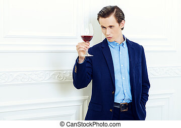 winetasting sommelier - Good looking young man with a glass...