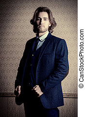 dark blue suit - Handsome young man in elegant suit and a...
