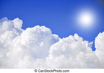 puffy clouds - blue sky and sunshine with big puffy clouds