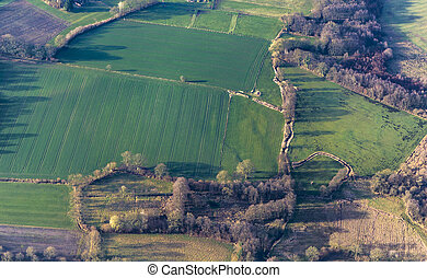 aerial view of green fields and slopes