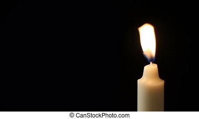 Candle - A single candle flickers and is blown out - with a...