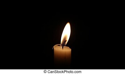Candle - A single close up candle slowly flicker with a...