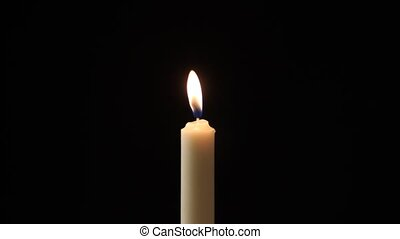 Candle - A single candle slowly flickers and is blown out -...