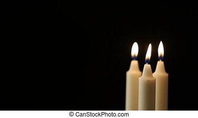 Candles - Multiple candles slowly flickers - with a black...