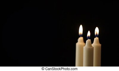 Candles - Multiple candles flickers - with a black...