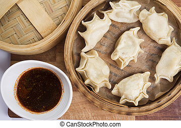 Chinese dim sum in traditional bamboo basket with tasty...