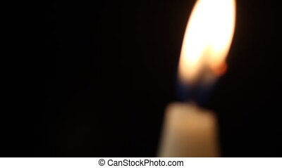 Candle - A single out of focus candle slowly flickers - with...