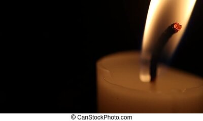 Candles - A single candle slowly flickers with a black...