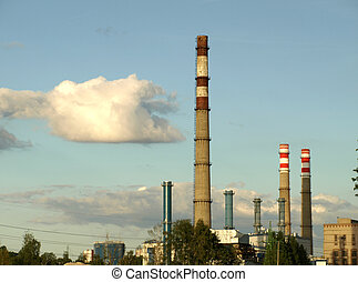 Huge industrial chimneys stopped producing smoke for a moment - environment protection concept