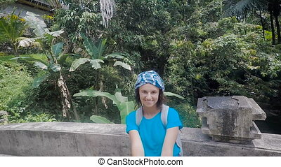 Island of Bali. An excursion on the island. The girl in blue...