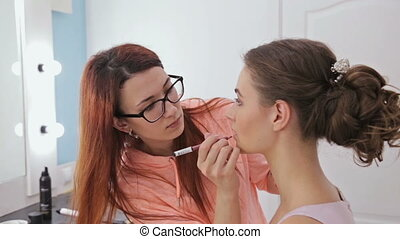 3 shots. Professional makeup artist applying contour on lips...