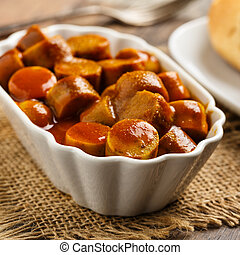 curried sausage - german currywurst - pieces of curried...