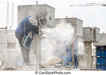 construction workers grinding in construction site