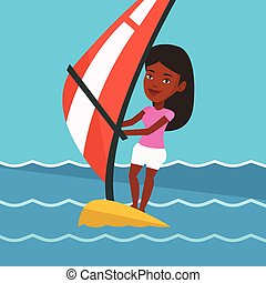 Young woman windsurfing in the sea. - African-american woman...