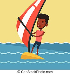 Young man windsurfing in the sea. - African-american man...