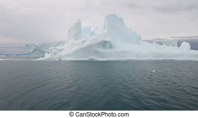 Lying in the icefjord - Lying in front of a huge iceberg in...
