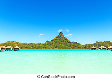 View on Mount Otemanu through turquoise lagoon and overwater...